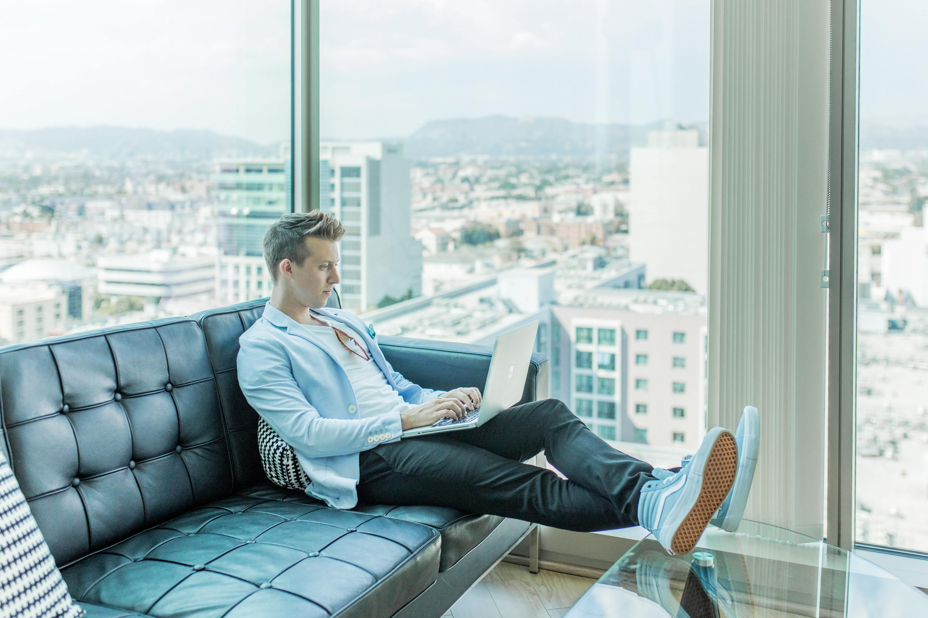 Man sitting with laptop and working remotely